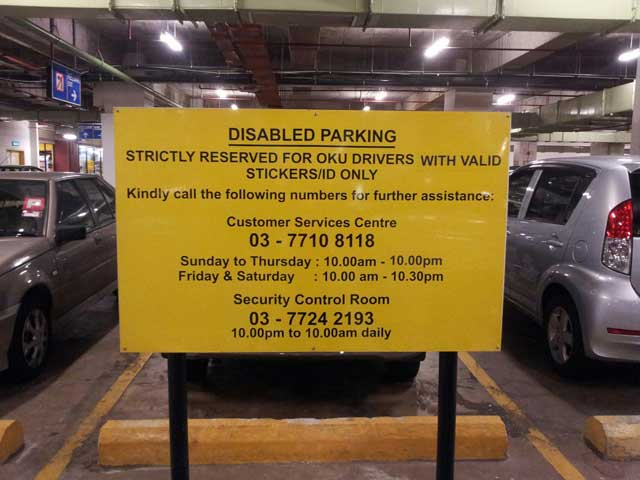 Signboard at 1 Utama indicating accessible parking only for disabled drivers