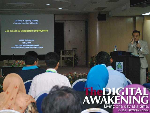 Dr. Kenji Kuno giving presentation on Job Coach at SOCSO