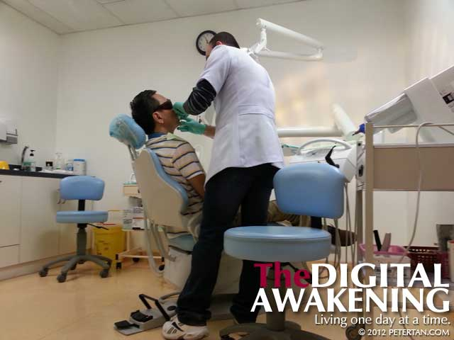 Dr. Ammar Musawi of IMU working on my dental crown