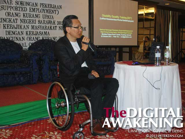 Peter Tan conducting a Disability Equality Training in Kuching, Sarawak