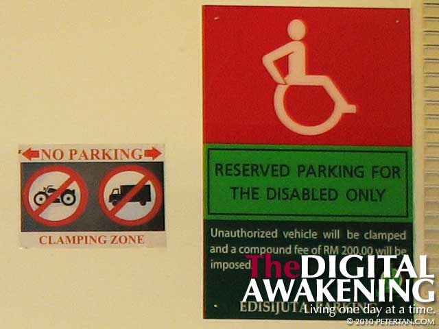 Signboard at Pavilion Kuala Lumpur warning against abusing accessible parking
